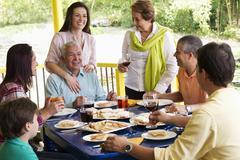 hispanic family enjoying meal together - stock photo