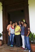 Hispanic family standing in doorway together Stock Photos