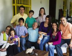 Hispanic family sitting on porch together Stock Photos