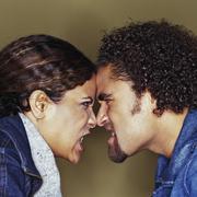 Grimacing couple having argument Stock Photos