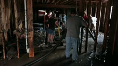 Flood house with water mud in basement workers P HD 2100 Stock Footage