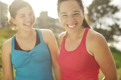 athletic women smiling together outdoors - stock photo