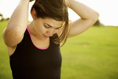 Athletic mixed race woman standing outdoors Stock Photos