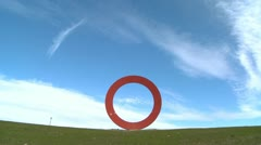 A sculpture of the letter o against an open sky. Stock Footage