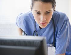 Brazilian doctor using computer Stock Photos