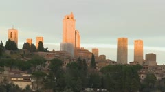 Time lapse behind the beautiful town of San Gimignano in Italy with shadows Stock Footage