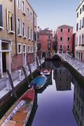 Boats moored on tranquil canal Stock Photos
