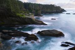 Ocean and rocky shore of remote area Stock Photos