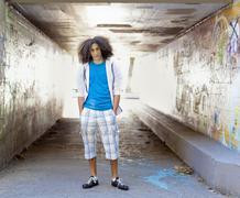 Mixed race teenager standing in urban underpass Stock Photos