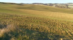 A slow pan across fallow fields in Tuscany, Italy. Stock Footage
