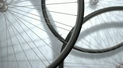 Close-up bicycle wheel spinning, shop, background.. Stock Footage