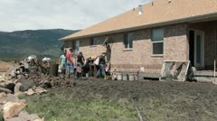 Flood volunteer helps clean destroyed property P HD 2027 Stock Footage