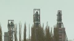 Three industrial derricks - stock footage