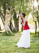 Caucasian woman playing with dog Stock Photos