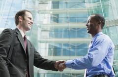Businessman shaking hands Stock Photos