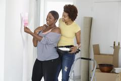 African American mother and daughter painting room Stock Photos