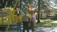 Stock Footage - Emergency Scene - Intense fire - Home, emergency crew and truck Stock Footage
