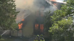 Stock Footage - Emergency  - firefighters battle intense fire, smoke and heat Stock Footage