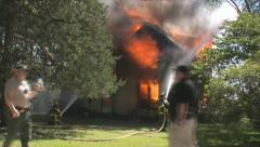 Stock Footage - Emergency Scene - Intense fire and smoke - Firemen Stock Footage
