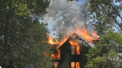 Stock Footage - Emergency Scene - wide shot of flames and damage to home Stock Footage