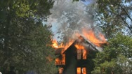 Stock Video Footage of Stock Footage - Emergency Scene - wide shot of flames and damage to home
