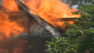 Stock Footage - Emergency - close up of flames and smoke coming out of roof Stock Footage