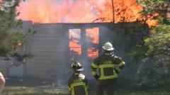 Stock Footage - Emergency Scene - Intense fire -Firefighters contain blaze Stock Footage