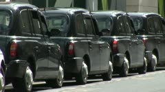 Row of London black cabs Stock Footage