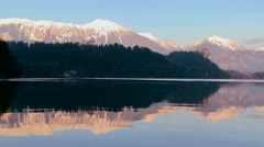 Beautiful reflections on the water at dawn at Lake Bled, Slovenia. Stock Footage