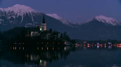 A small church on an island at dawn at Lake Bled, Slovenia. - stock footage