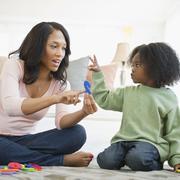 Afrikkalainen amerikkalainen äiti opetus poika numerot Kuvituskuvat