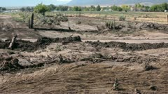 Flood mud destruction across farm fields and road P HD 2392 Stock Footage