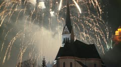 A magnificent fireworks display behind a church. Stock Footage
