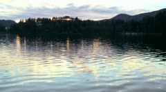 Beautiful reflections on a rural lake. - stock footage