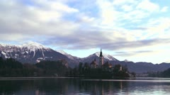 A church stands on a small island in Lake Bled, Slovenia. Stock Footage