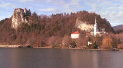 A beautiful medieval castle and church on the shores of Lake Bled, Slovenia. Stock Footage