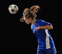 Caucasian soccer player heading the ball Stock Photos