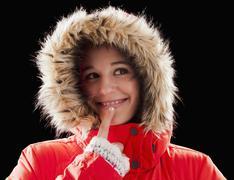Caucasian woman wearing fur-hooded coat Stock Photos