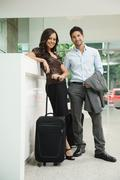 Business people arriving at hotel Stock Photos
