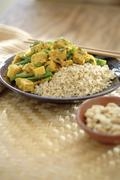 Curry soy tempeh and rice in bowl - stock photo