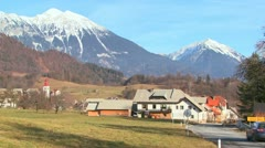 Cars drive through the countryside of Slovenia or an Eastern European nation. Stock Footage