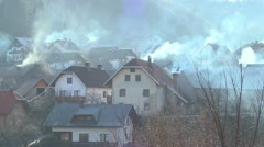 Villages in Eastern Europe pollute the environment by burning wood and coal. - stock footage
