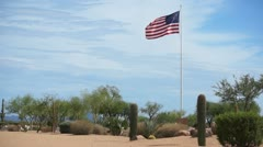 USA Flag Flying High in the Desert Stock Footage