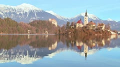 A church stands on an island at Lake Bled, Slovenia. Stock Footage