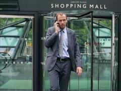 Young handsome businessman talking on mobile phone, slow motion NTSC - stock footage