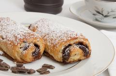 Powdered sugar on chocolate croissants - stock photo