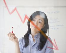Japanese businesswoman drawing red arrow Stock Photos