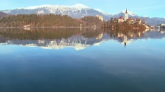 A beautiful church stands on an island on Lake Bled, Slovenia. - stock footage