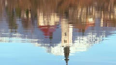 The reflection of a church steeple in the waters of Lake Bled, Slovenia. - stock footage