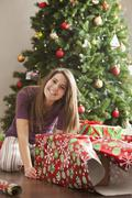 Caucasian woman wrapping Christmas gifts Stock Photos